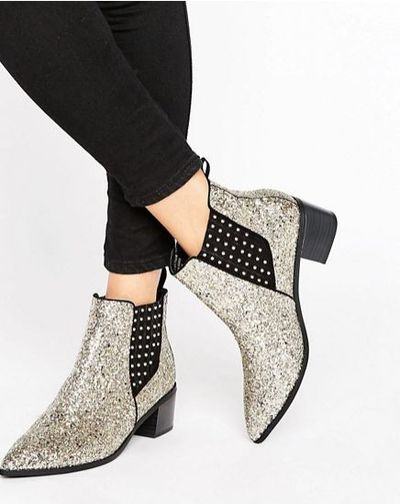 """Office Amber silver boots, $147 at <a draggable=""""false"""" href=""""http://www.asos.com/au/office/office-amber-silver-glitter-chelsea-boots/prd/7031903?iid=7031903&clr=Silverglitter&SearchQuery=&cid=4172&pgesize=2&pge=0&totalstyles=2&gridsize=3&gridrow=1&gridcolumn=2"""" target=""""_blank"""">ASOS</a>"""