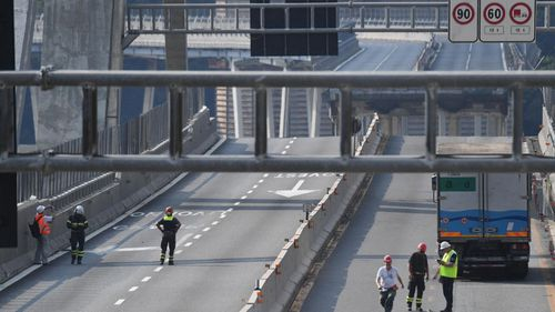 Technicians at work to verify the stability of the Morandi Bridge in Genoa