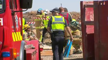 Workers freed from collapsed trench