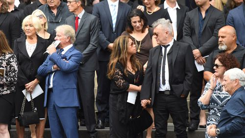 Jimmy Barnes and his wife Jane join family, friends and fellow musicians of AC/DC co-founder and guitarist Malcolm Young during his funeral at St Mary's Cathedral (Image: AAP)