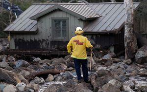 Rescue workers comb sludge for mudslide victim's bodies