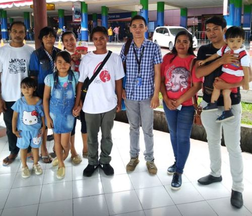 Aldi Novel Aldilang, 19, fourth from right, with his family after he returned to Indonesia.