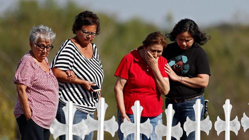 Mourners visit the 26 victims representing victims of the Sutherland Springs shooting. (AAP)