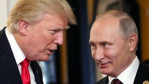 Russian President Vladimir Putin and US President Donald J. Trump talk at the break of a leader's meeting at the 25th Asia-Pacific Economic Cooperation (APEC) summit in Da Nang, Vietnam. (AAP)
