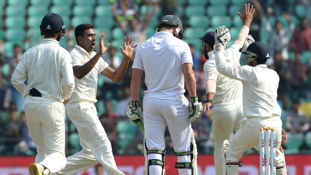 Indian players celebrate a wicket during their Third Test win over South Africa. (AFP)
