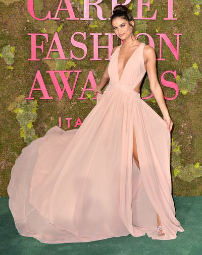 Model Sara Sampaio in Alberta Ferretti.This nude Global Organic Textile Standard (GOTS) certified organic silk georgette dress has been produced in Florence and all other components for this bespoke piece have been repurposed from unused samples from Alberta Ferretti past collections.