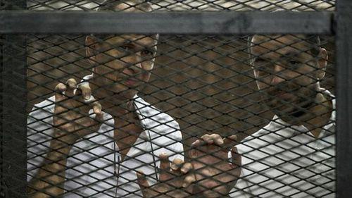 Peter Greste's Al-Jazeera colleagues freed ahead of retrial