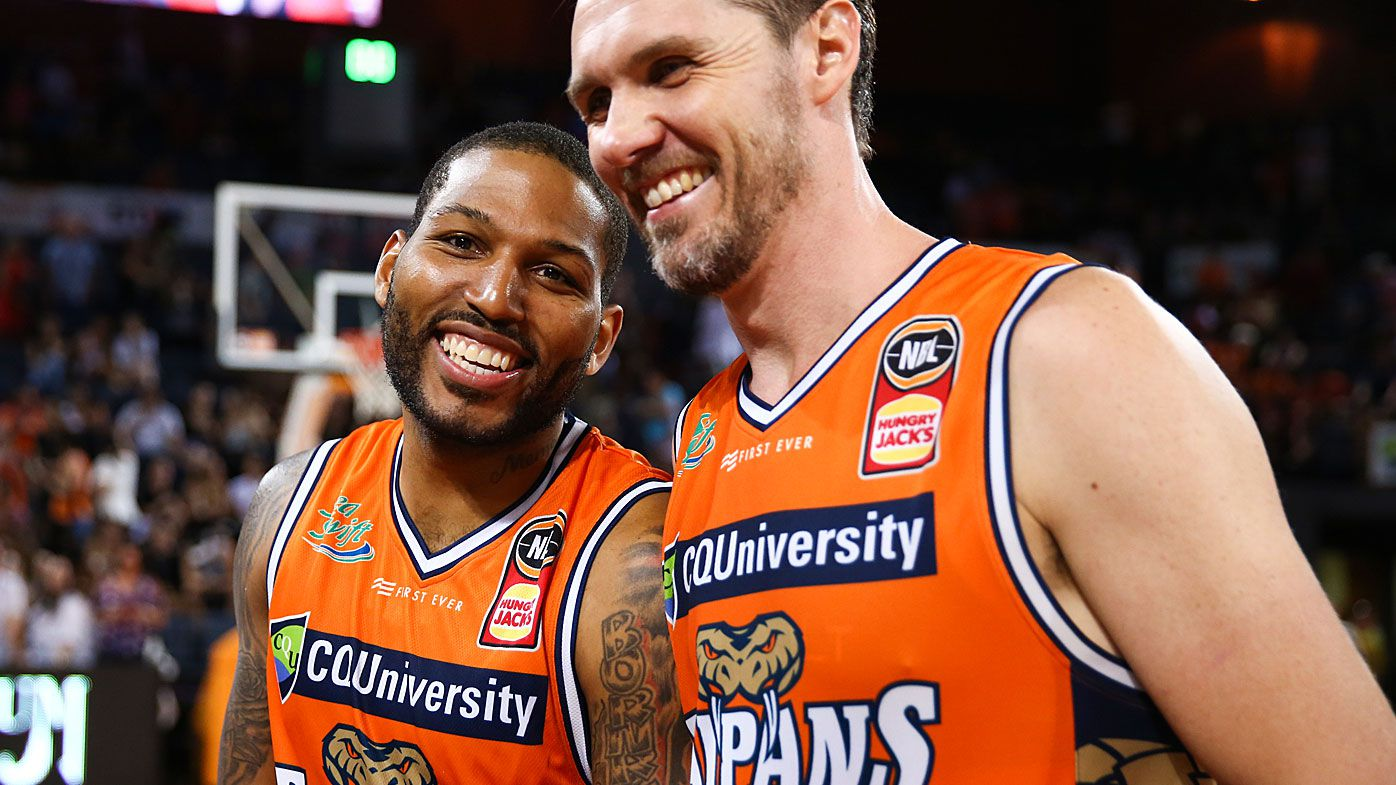 Cairns Taipans celebrate their win