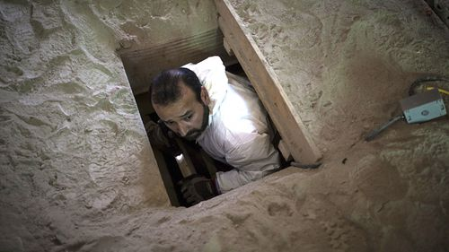 A man comes out of the tunnel Joaquin 'El Chapo' Guzman used to escape, during an operation on the surroundings of Mexican Maximum Security Prison of 'El Altiplano' on July 15, 2015 in Mexico City, Mexico