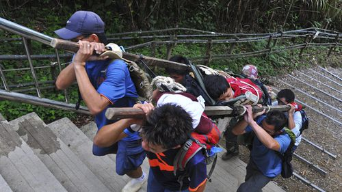 Schoolchildren from Singapore were among those rescued. (AAP)
