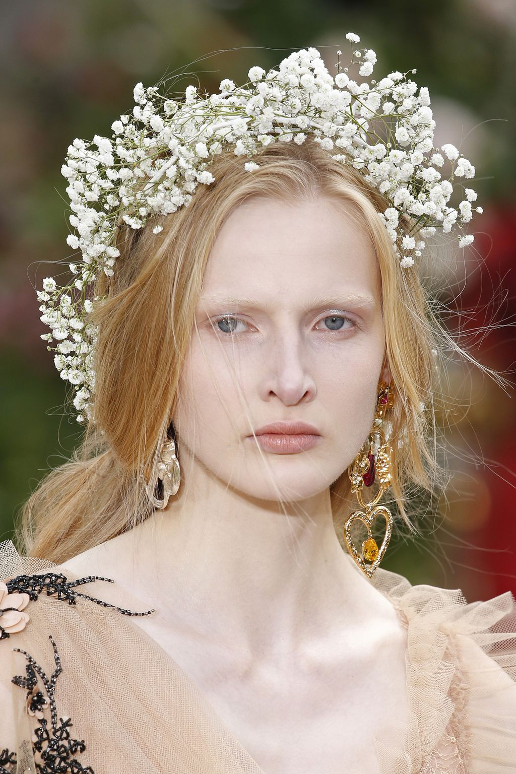 Flower crowns steal the show at paris fashion week floral wreaths made from gypsophila colloquially known as babys breath adorned the heads and arms of models as they floated down the catwalk izmirmasajfo