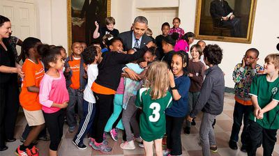 The Secret Service would not have appreciated this breach in protocol as children taking part in the White House Healthy Kids & Safe Sports Concussion Summit embrace the president. (Flickr/White House)