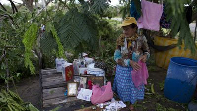 A local dries her belongings in La Fortuna. (AAP)