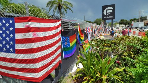 People pay tribute to the victims of one of the deadliest mass shooting in modern US history at Pulse, a gay club, in Orlando, Florida. (AP).