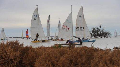 The lake's yacht club has a dedicated group of sailors who only manage to enjoy the water every few years.