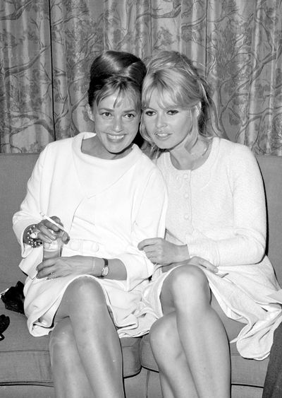 Jeanne Moreau with Brigitte Bardot in the Air France lounge at Kennedy Airport, 1965.