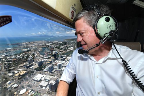 Tim Nicholls above Townsville in a helicopter today. (AAP)