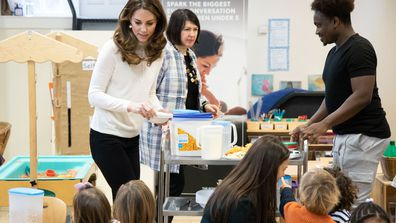The Duchess of Cambridge Kate Middleton and Mrs Giovanna Fletcher served breakfast to the children at the Stockwell Gardens Nursery