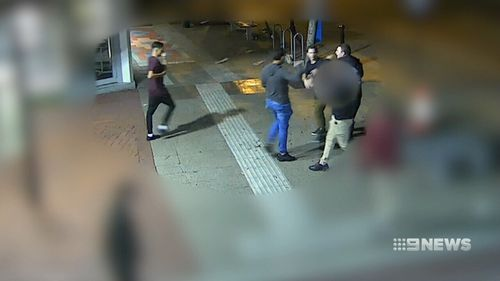 The woman was hit in the back of the head with a brick. (9NEWS)