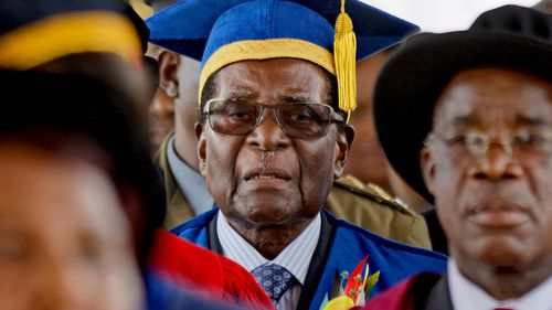 President Robert Mugabe attends a graduation ceremony in his first public appearance since Zimbabwe's military put him under house arrest. (AAP)