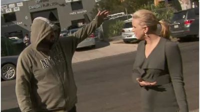 'F--- off': 9NEWS reporter confronted by man while reporting on raids