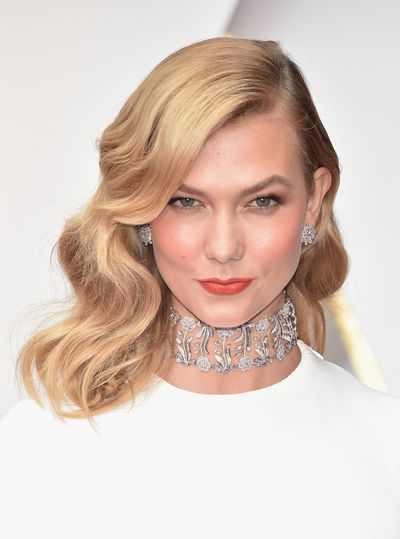 Karlie Kloss in classic true red lipstick teamed with Veronica Lake-style curls.