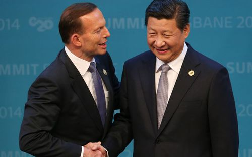 Tony Abbott welcomes China's President Xi Jinping to the G20. (Getty)