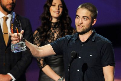 "Robert Pattinson accepted the award on behalf of the cast. They beat <i>Moneyball</i>, <i>The Help</i>, <i>Limitless</i> and <i>The Adjustment Bureau</i>.<br/><br/><b><a target=""_blank"" href=""http://celebrities.ninemsn.com.au/blog.aspx?blogentryid=969643&showcomments=true"">Click to vote: R-Pattz's new hair - love it or hate it?</a></b>"