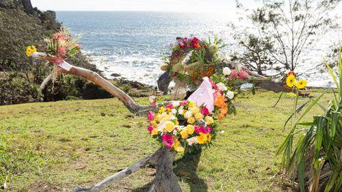 Community members lay flowers in memory of the missing fishermen.