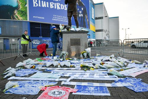 Flowers and tributes left by the statue of Cardiff City footballer Frederick Charles Keenor outside Cardiff City Football Club.