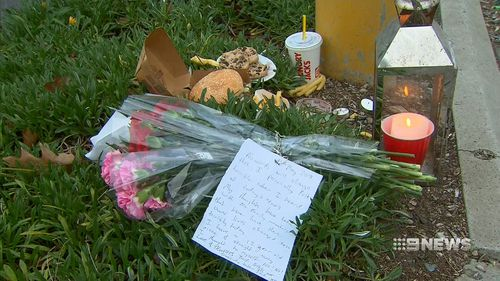 Flowers and notes from devastated community members were left at the scene. (9NEWS)