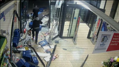 This is the moment brazen thieves smash a stolen car through an Aldi store.