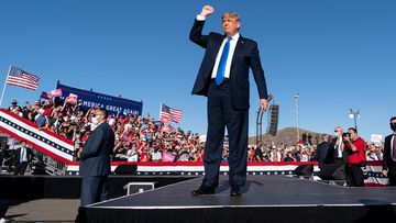 President Donald Trump arrives to speak at a campaign rally at Carson City Airport