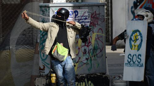 Two teens and a soldier have been killed during deadly clashes in Venezuela. (AFP)