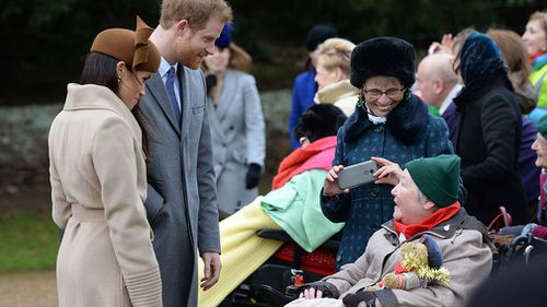 Markle and Prince Harry speak to members of the public. (AAP)