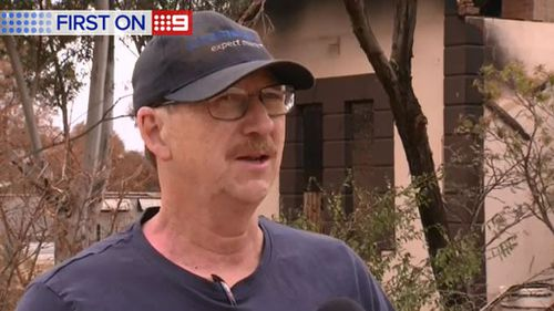 Martin Durnford woke to find a man looting through his burnt out house. (9NEWS)
