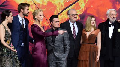 Actress Jena Malone, Australian actor Liam Hemsworth, US actress Jennifer Lawrence, US actor Josh Hutcherson, US director Francis Lawrence, US actress Willow Shields, and US actor Donald Sutherland pose for photographers.
