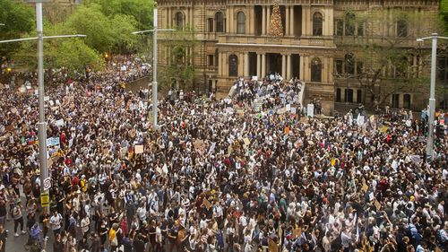 Protestors at Town Hall in Sydney yesterday.