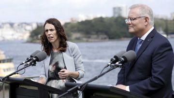 Jacinda Ardern and Scott Morrison at a press conference outside Kirribilli House.