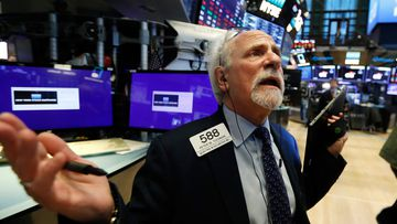 Trader peter Tuchman on the floor of the New York Stock Exchange, where the Dow Jones has been hammered over the past week.