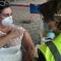 Bride wears her wedding reception dress to receive her coronavirus vaccine