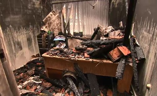 Man charged over office destroyed by fire
