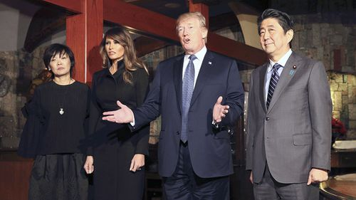 Donald Trump, his wife Melania, and Shinzo Abe and his wife Akie arrive at the Ginza Ukai Tei restaurant to have a dinner in Tokyo. (AAP)