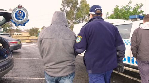 Search warrants were also executed on homes at Prestons and Abbotsbury.