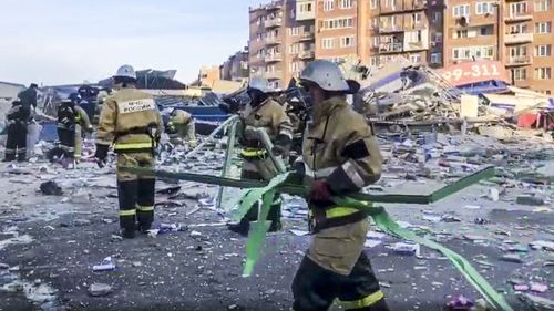 Russian Emergency Ministry employees work at a scene of a powerful explosion in Vladikavkaz, Russia, Friday, Feb. 12, 2021