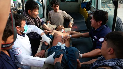 A man who was injured in a deadly suicide bombing that targeted a training class in a private building in the Shiite neighborhood of Dasht-i Barcha is placed in an ambulance in western Kabul.