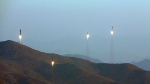 An undated file photo released by the North Korean Central News Agency on 7 March 2017 shows four projectiles during a ballistic rocket launching drill at an undisclosed location. (AAP)