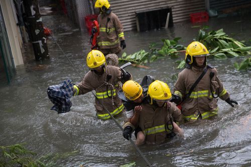 Rescue workers have helped dozens to safety in Hong Kong.