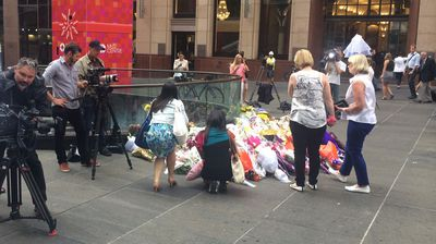 More workers stopping to pay their respects in Martin Place. (Supplied)
