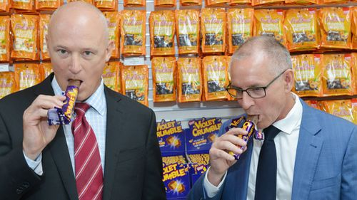 Phil Sims and Jay Weatherill sample the product today. (AAP)
